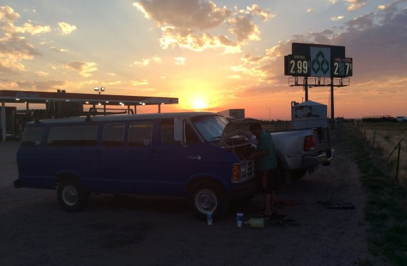 van broken down at sunset